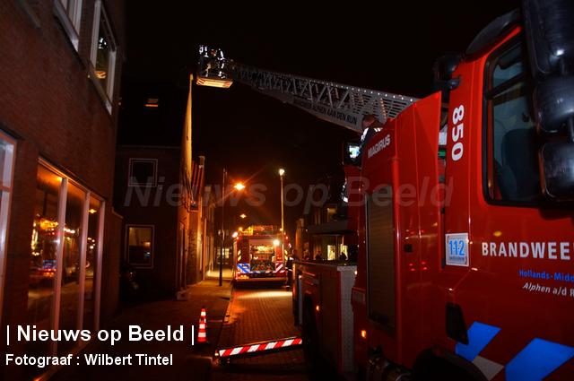 Schoorsteen in brand Dorpsstraat Hazerswoude Dorp