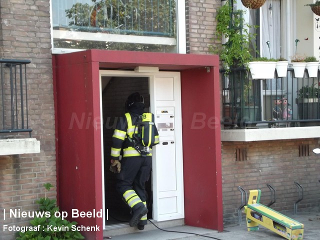 Tas met werkkleding vat vlam in woning Wijnruitstraat Rotterdam