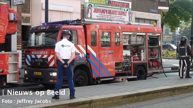 27-09-13-1e-middellandstraat-grote-brand-6.jpg