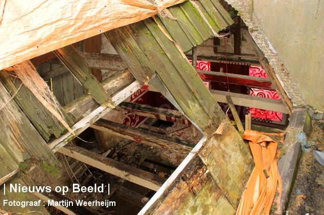 04-10-13-dak-ingestort-vlaardingen-BorderMaker-11.jpg