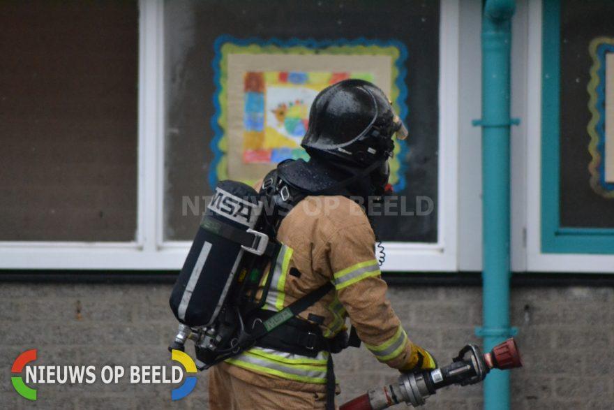 Stockfoto brandweerman brand blussen joey