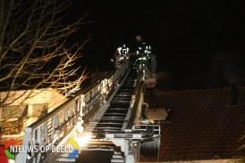 Brandweer blust brandende resten uit schoorsteen Melchior Treublaan Leiden