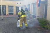 Brandweer rukt uit voor brandende wasmand Boutershof Hendrik-Ido-Ambacht