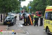 Auto op zijn kant bij aanrijding Erasmusweg Den Haag