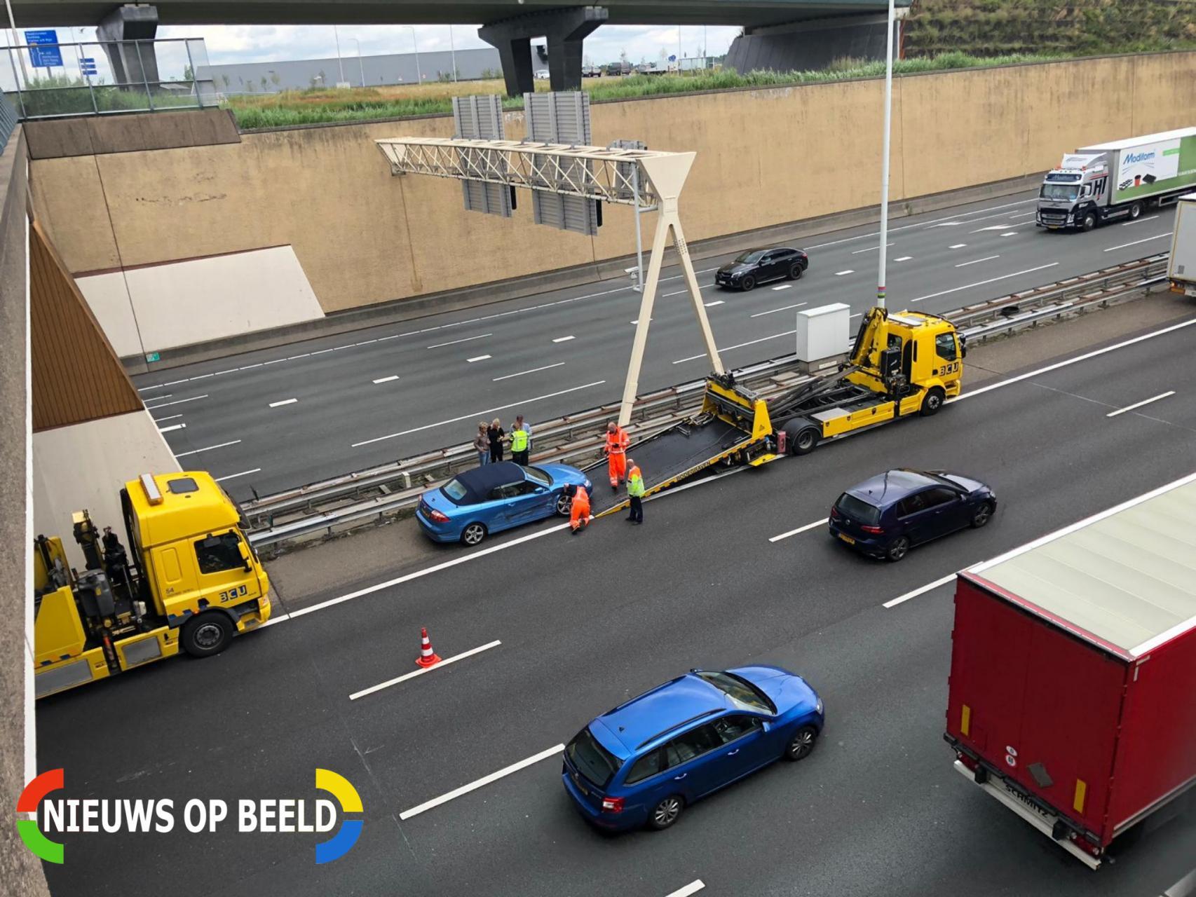 File na botsing tussen auto en vrachtwagen Rijksweg A12 Waddinxveen