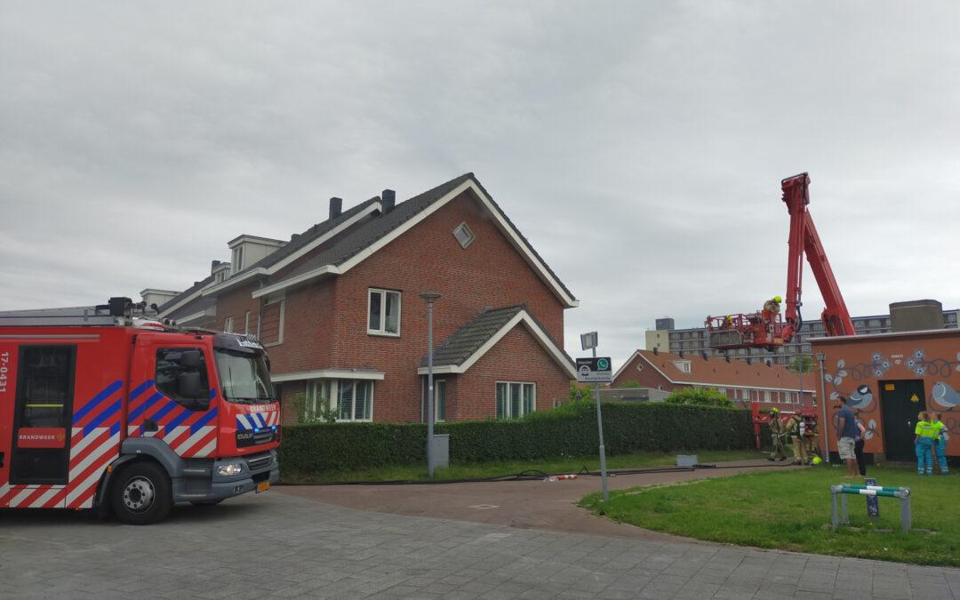 Brand in spouwmuur van woningen Burgemeester Noletlaan Rotterdam